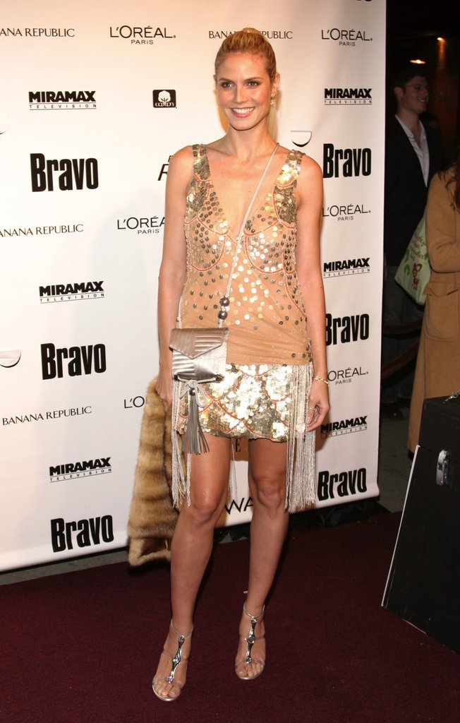 For Project Runway's 2005 launch, Klum played the part of hostess with the mostest working a glitzy drop-waist flapper dress with jeweled sandals and a plush fur wrap.