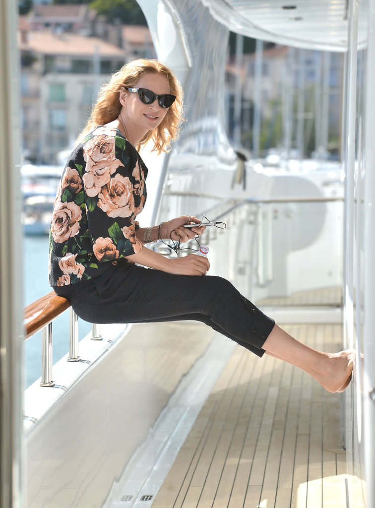 Uma Thurman checked her phone during a relaxing boat ride during the Cannes Film Festival in May.