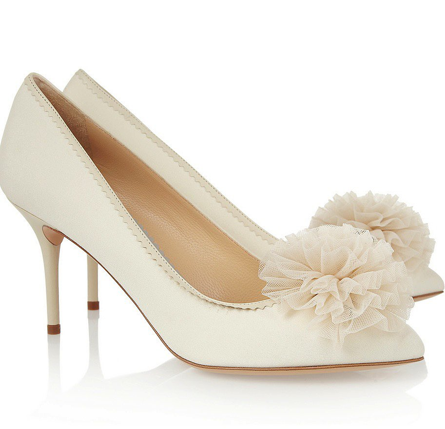 Pair a classic, low-heeled white pump — like these Charlotte Olympia pom-pom pumps ($900) — with a tea-length dress for an altogether retro feel. While the closed-toe look is fair game in the colder months, this style totally goes with shorter dress lengths year-round.