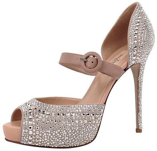 These Valentino embellished peep-toe pumps ($995) would look just as dazzling on your wedding day as they would on your honeymoon with a little black dress.
