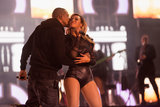 The couple we didn't think could get any cuter did when Jay Z planted a kiss on Beyoncé on stage during their performance at the Chime For Change benefit.