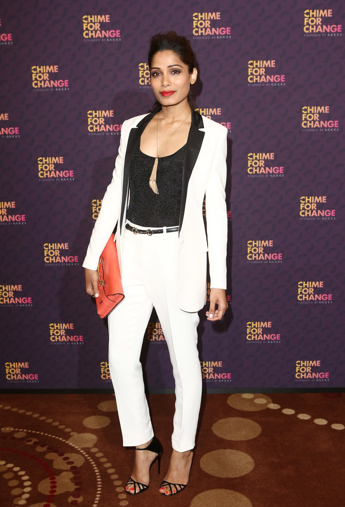 Freida Pinto took the menswear route in a white tuxedo suit by Gucci and finished it with a coral Gucci horsebit clutch.