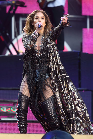 Jennifer Lopez belted out a tune in an eclectic ensemble, which included a long cape-like jacket and thigh-high boots.