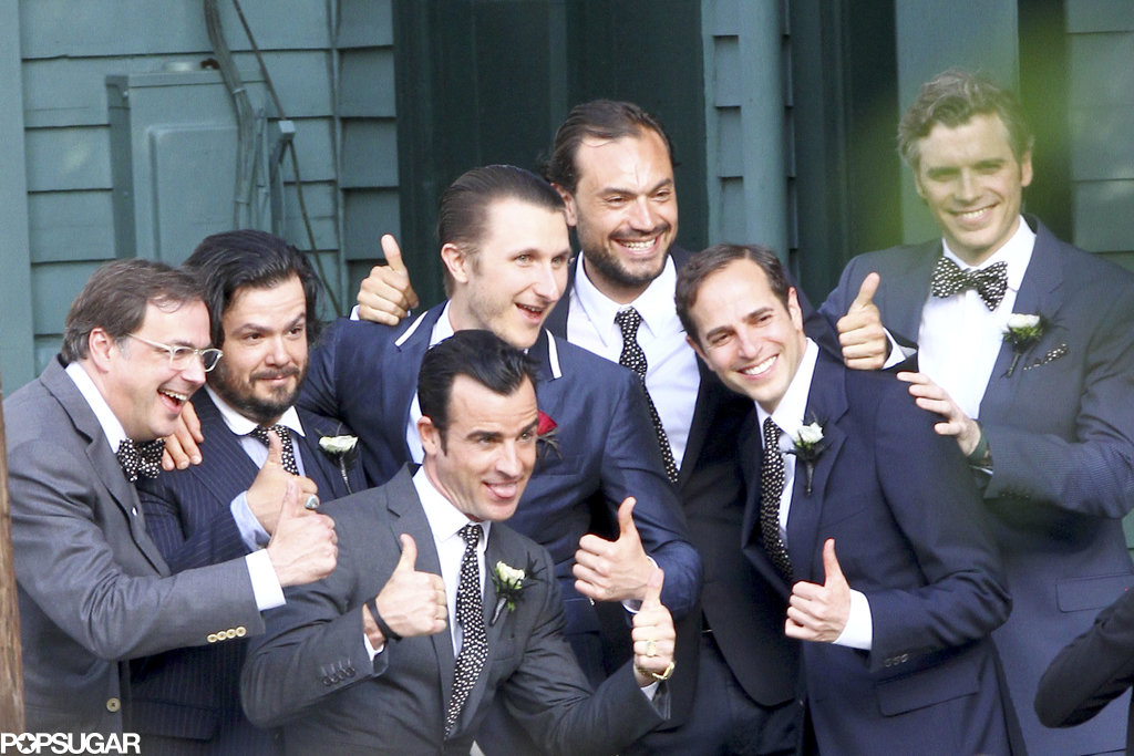 Justin Theroux and Scott Campbell threw their thumbs up with their guy friends after Scott tied the knot with Lake Bell in New Orleans in June 2013.