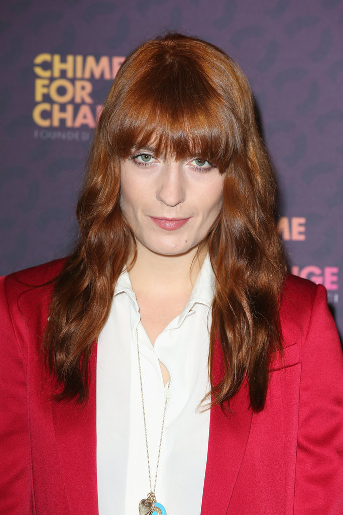 Straying from her typical wild styles, Florence Welch wore her long red hair in beachy waves with her blunt bangs on display.