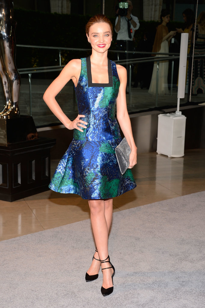 Miranda Kerr's blue eyes popped thanks to her vivid blue and green fit-and-flare printed Proenza Schouler dress, which she completed with a silver clutch and black pumps, both by Stuart Weitzman. Her jewelry was from nominee Jennifer Meyer.