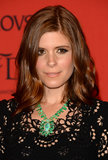 Opting for a more casual style, Kate Mara accented her sideswept waves with a heavily lined eye makeup look.
