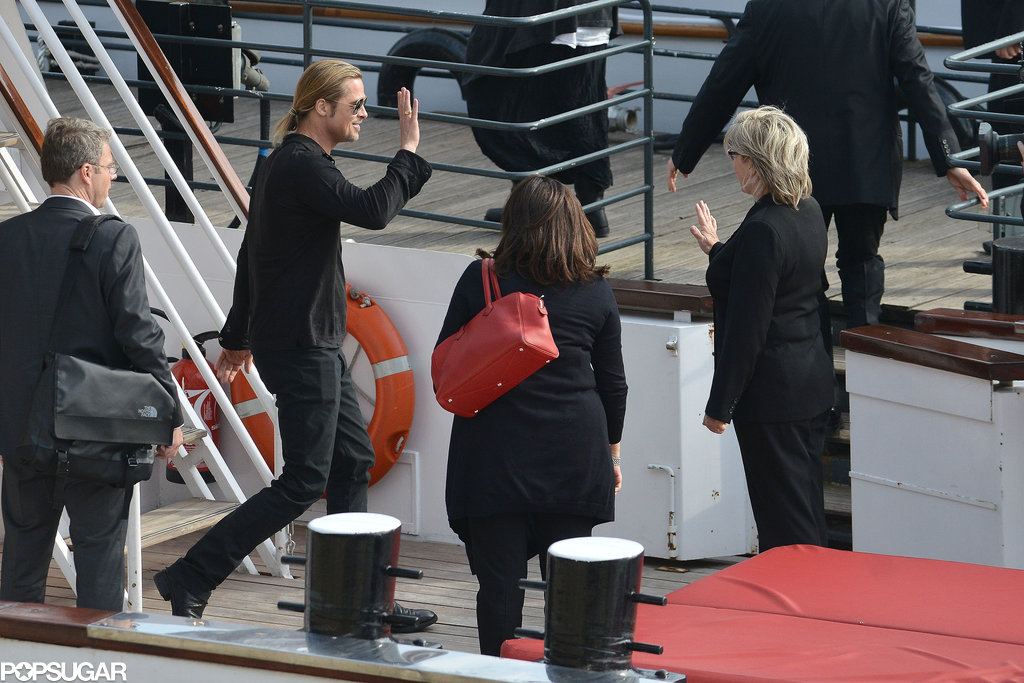 Brad Pitt left an interview on board a yacht in Paris on Monday.