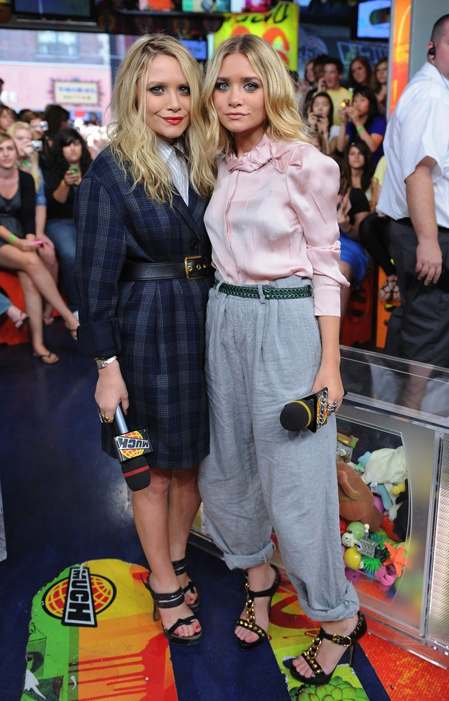 Twinning combo: Mary-Kate and Ashley exuded schoolgirl charm while visiting the MuchOnDemand TV studio in Toronto in March 2009.  Mary-Kate was made for plaid in her Elizabeth and James boyfriend jacket and python Prada sandals. Ashley tucked a blush-pink blouse into cuffed grey trousers, then slipped on her trusty Prada sandals for a touch of edge.