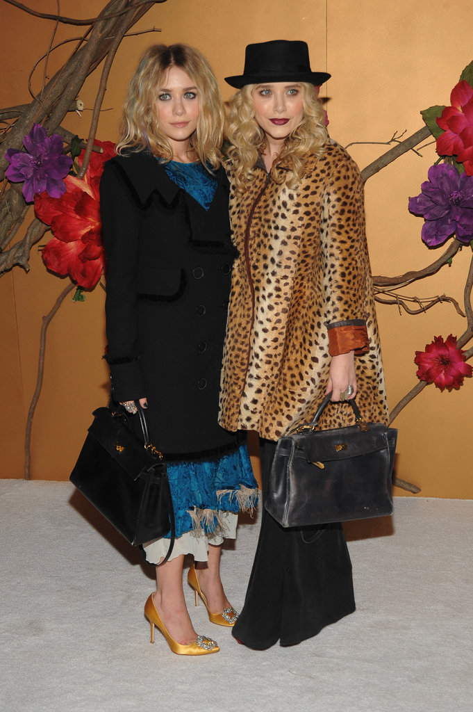 Twinning combo: The Olsens celebrated Tim Burton at a November 2009 MOMA film benefit with quirky couture styles and matching black leather satchels.  Ashley played up her faint blue streaks with a ruffled turquoise dress and mustard-colored satin pumps. Mary-Kate channeled Tim Burton's quirky side with a leopard coat, wide-leg trousers, and a porkpie hat.
