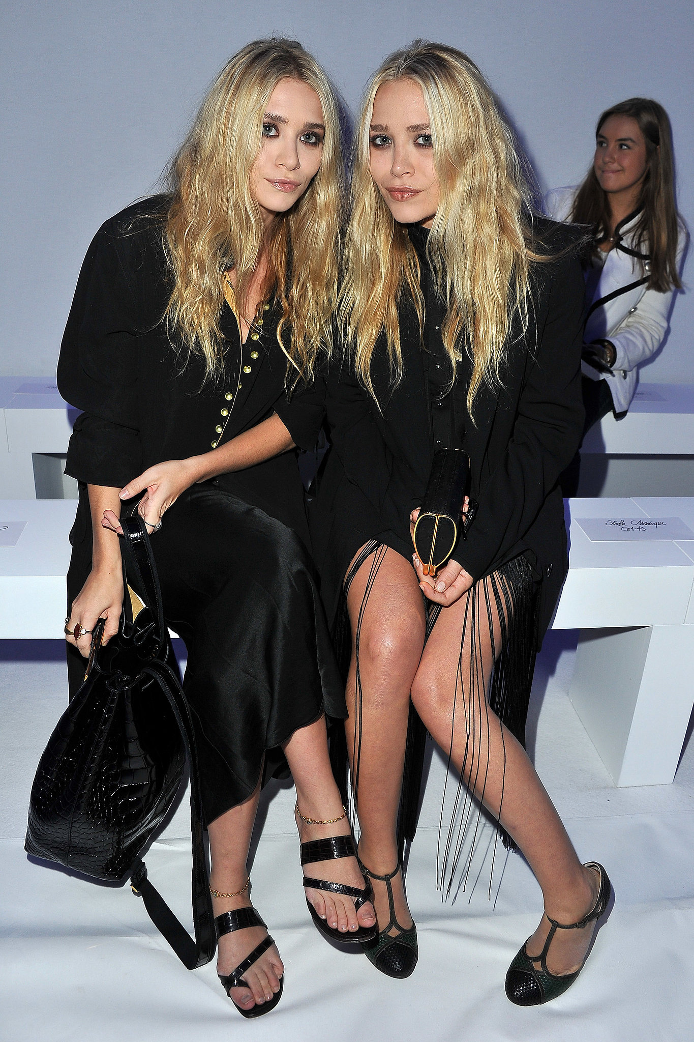 Twinning combo: The girls have mastered the art of monochromatic dressing as shown by this front-row look during Paris Fashion Week Spring/Summer 2012.  Ashley paired a puff-sleeved top with a silky maxi skirt and leather sandals. Mary-Kate buttoned up in a black oxford shirt, fringed skirt, and tuxedo jacket.