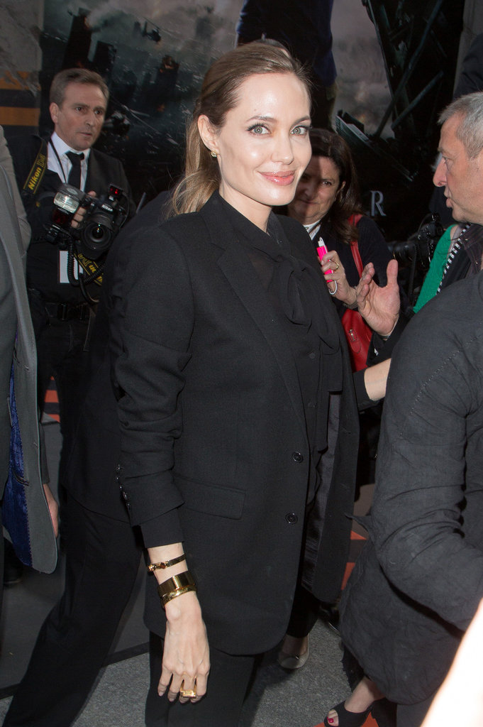 Angelina added interest to her black-on-black suit with a wrist full of bold bangles and subtle earrings.