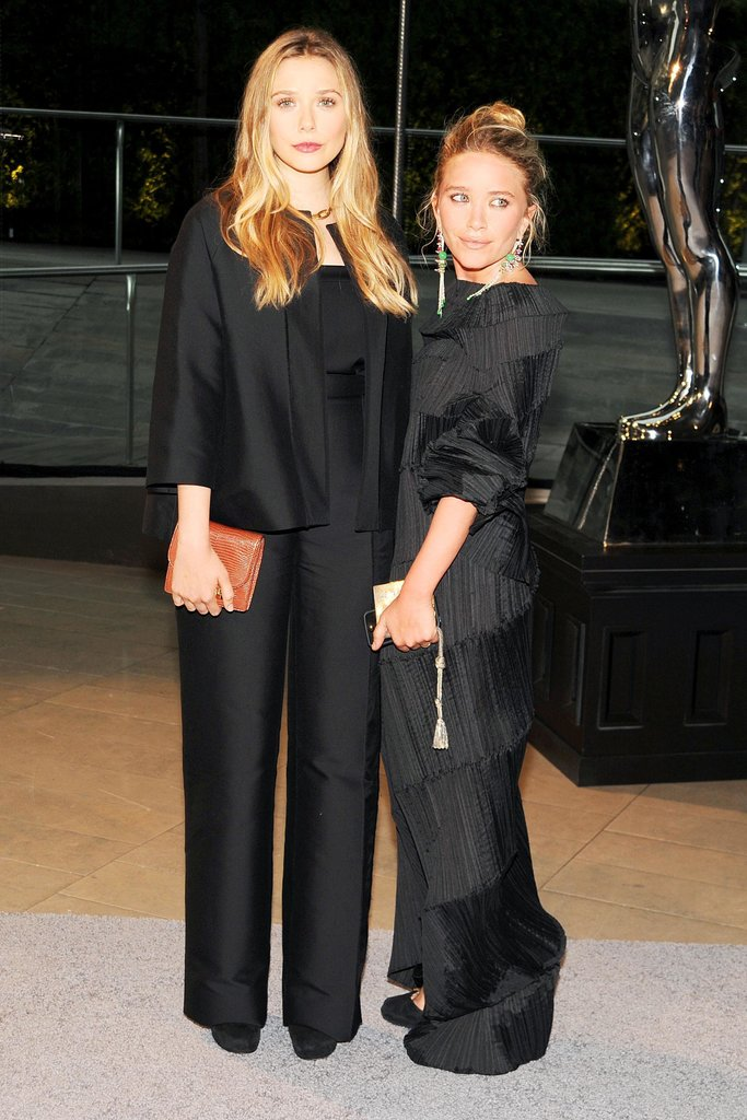 Elizabeth Olsen, in The Row, with Mary-Kate Olsen, in vintage Issey Miyake. Source: Billy Farrell/BFAnyc.com