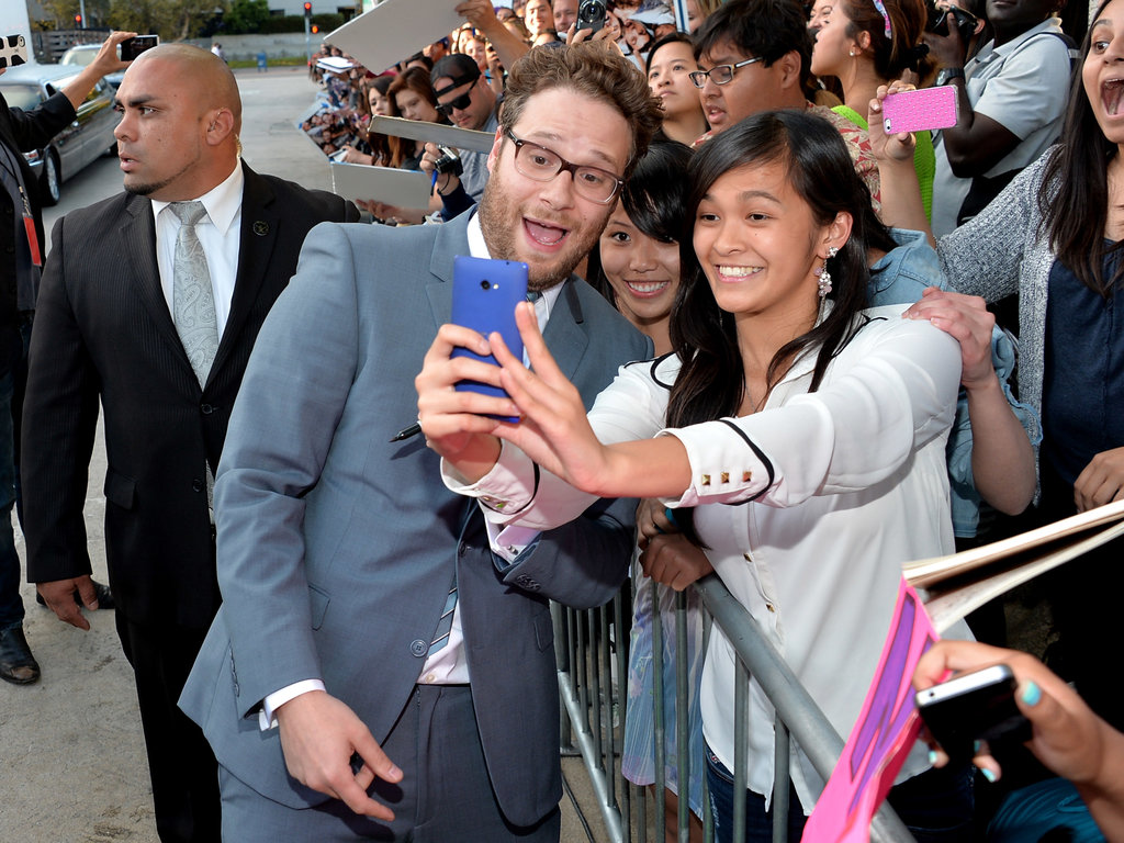 Seth Rogen stopped for a snap with fans during the LA premiere of This Is the End.
