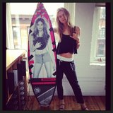 Behati Prinsloo posed with her personalised surfboard. Source: Instagram user behatiiprinsloo