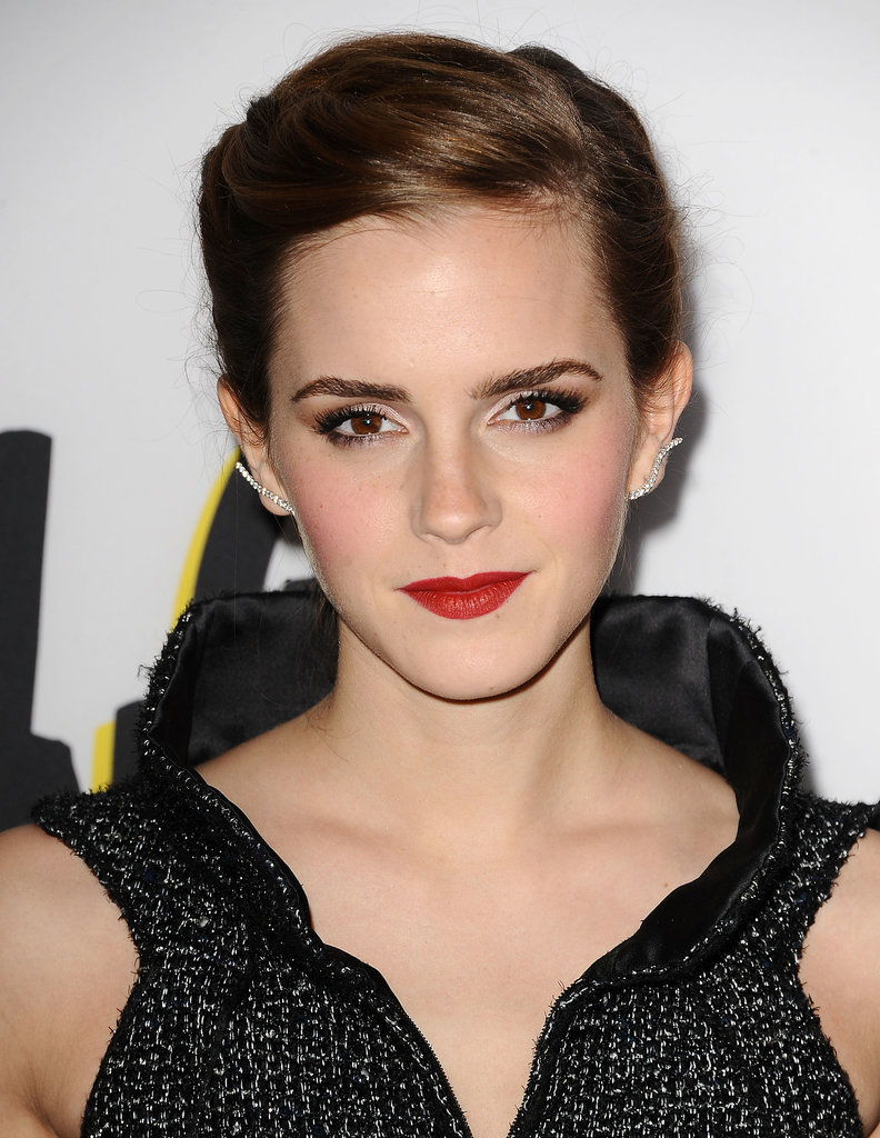 From the front, it appears Emma Watson opted for a classic beauty look with a matte red lipstick and flushed cheeks . . .