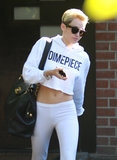 Miley Cyrus showed off her stomach for a stop at the studio.