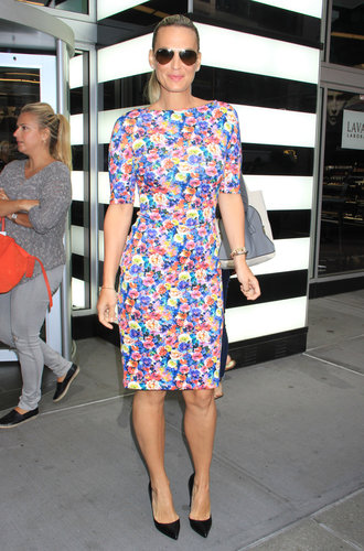 Molly Sims punched up the streets of NYC when she sported this Zara floral dress ($90) with black pumps and Ray-Ban aviators.