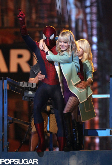 Andrew Garfield and a smiling Emma Stone swung into action on Monday night in New York City on the set of The Amazing Spider-Man 2.