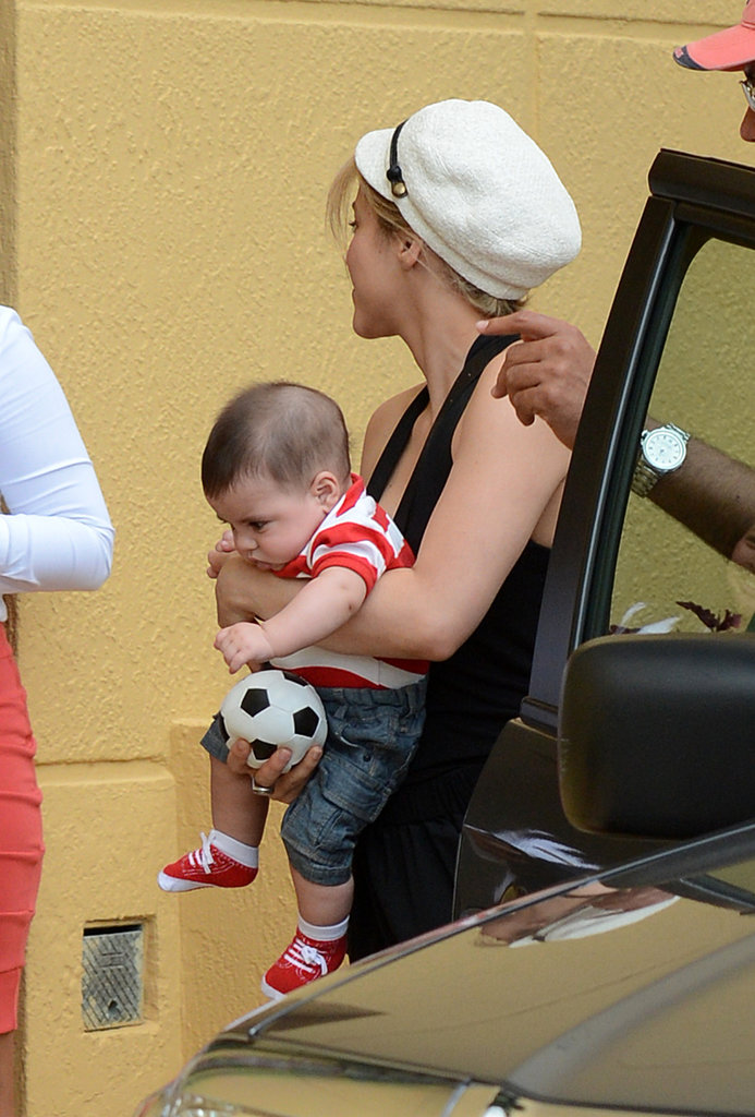 Shakira held onto Milan's toy soccer ball.