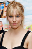 Sienna Miller's messy ponytail and dark, rimmed eyes.