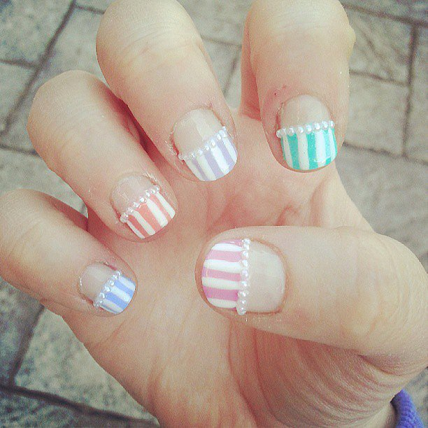 This gorgeous, pastel manicure is adorned with tiny pearls. Source: Instagram user classily_yours