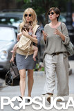 Sienna Miller walked in NYC with Phoebe Nicholls and baby Marlowe Strurridge.