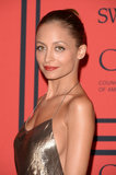 Nicole Richie's topknot and smooth bronzed skin.