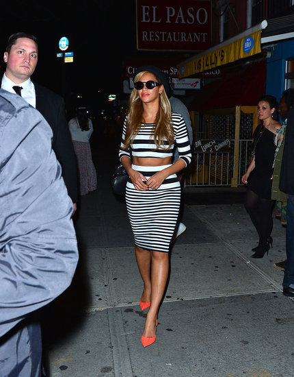 After leaving Kanye West's birthday in NYC, Beyoncé showed off her amazing figure in a striped crop top and matching skirt, both by Topshop, and bright orange pumps.