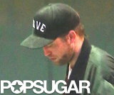 Robert Pattinson wore a baseball cap.
