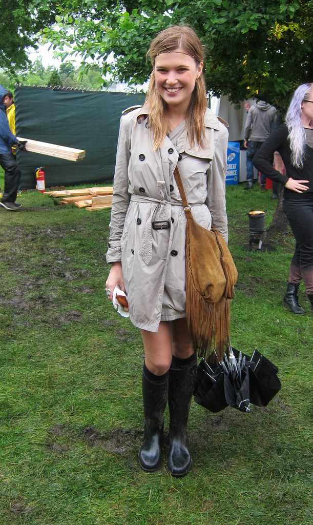 The classic trench, built for inclement weather, is always smart for less than ideal forecasts. Music festival-ize it with fringed accessories and a headband. Source: Leah Melby