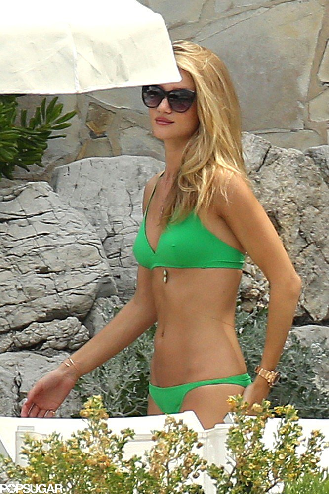 Rosie Huntington-Whiteley showed off her abs in a bright green bikini.