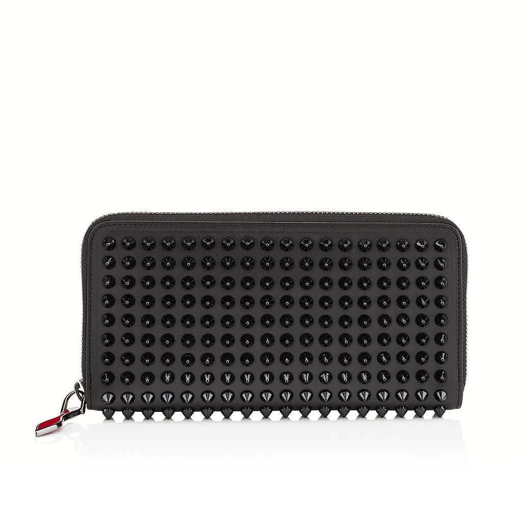 For those that consider shopping a little like going to war: an all-black, spike-covered zip-up wallet ($625).