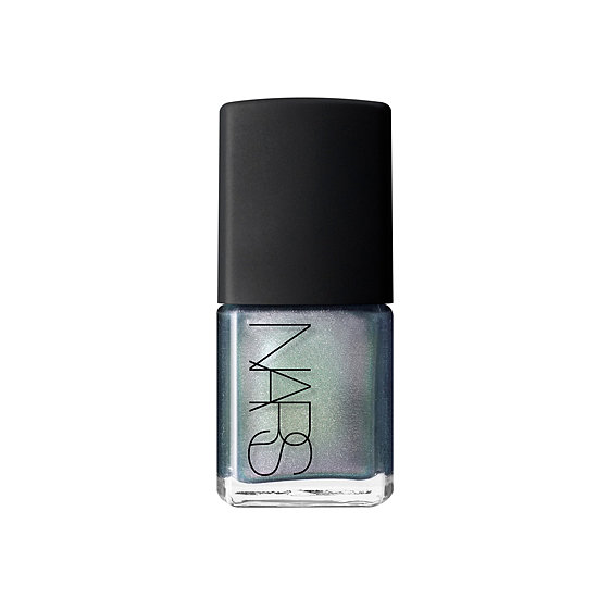 Swipe on Nars Disco Inferno ($19), an iridescent silver green, for a groovy manicure. Can you dig it?