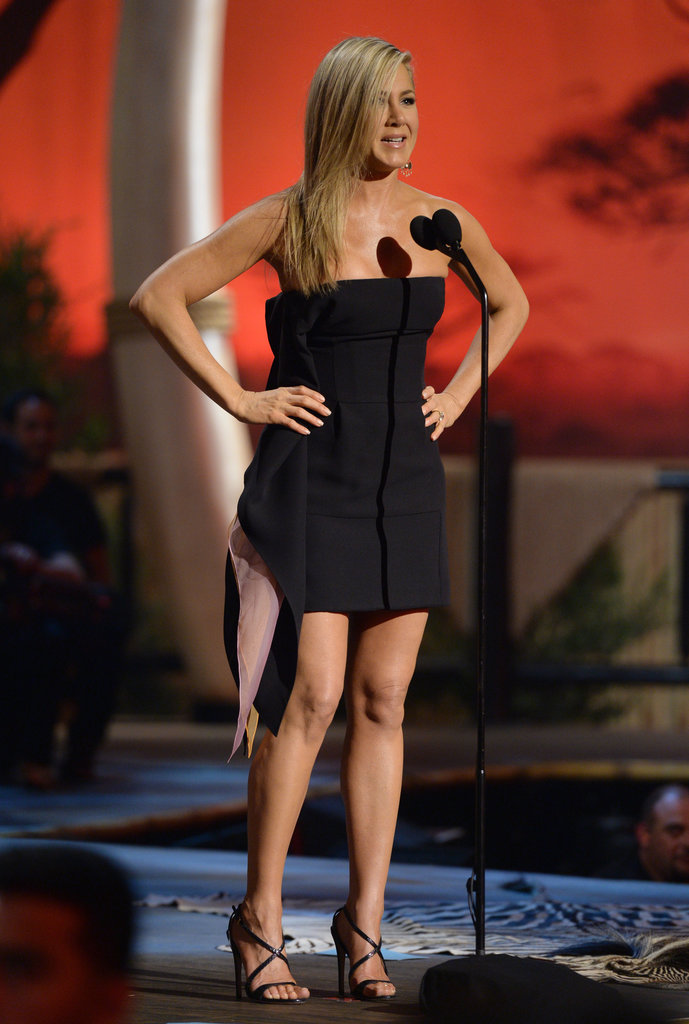 Jennifer Aniston hit the Guys Choice Awards stage looking equally classy and sassy in a black strapless Dior dress with pink and orange organza inserts.