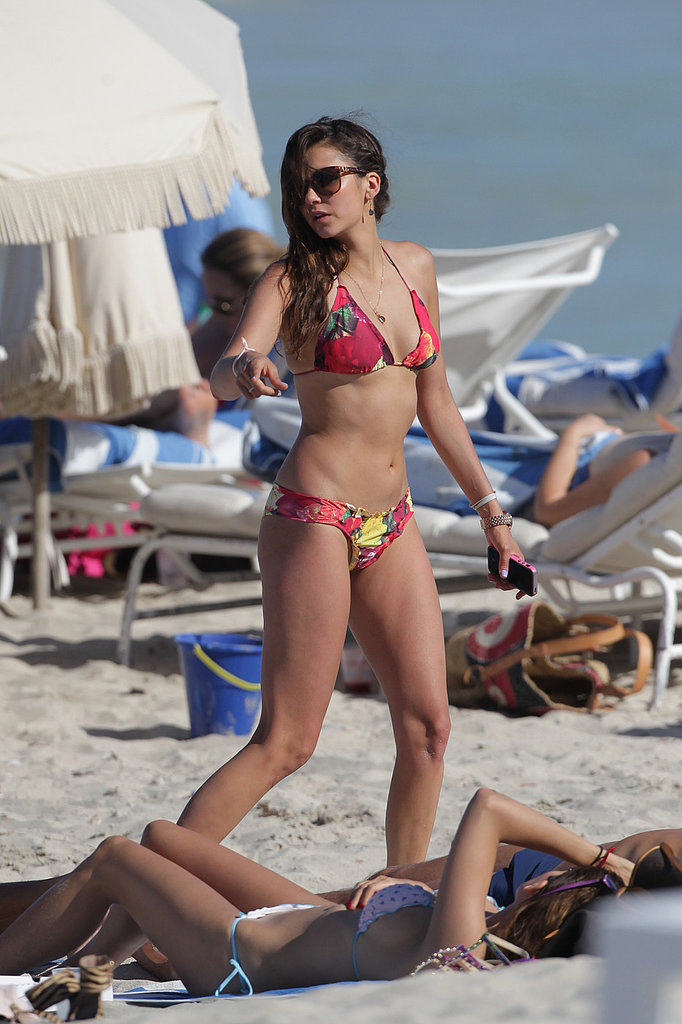 Nina Dobrev wore an over-the-shoulder style with a plait to create an undercut effect while basking at the beach.