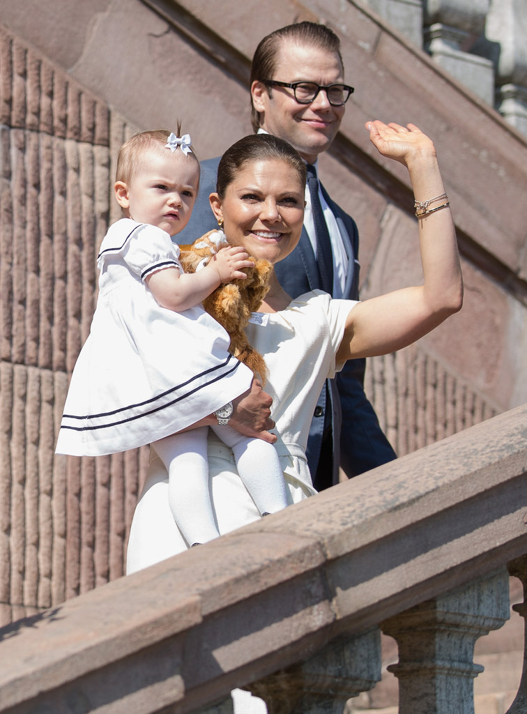 Princess Estelle helped her mom, Crown Princess Victoria, celebrate Sweden's National Day on Friday, sporting an adorable bow as the pair addressed the crowd with dad Prince Daniel.