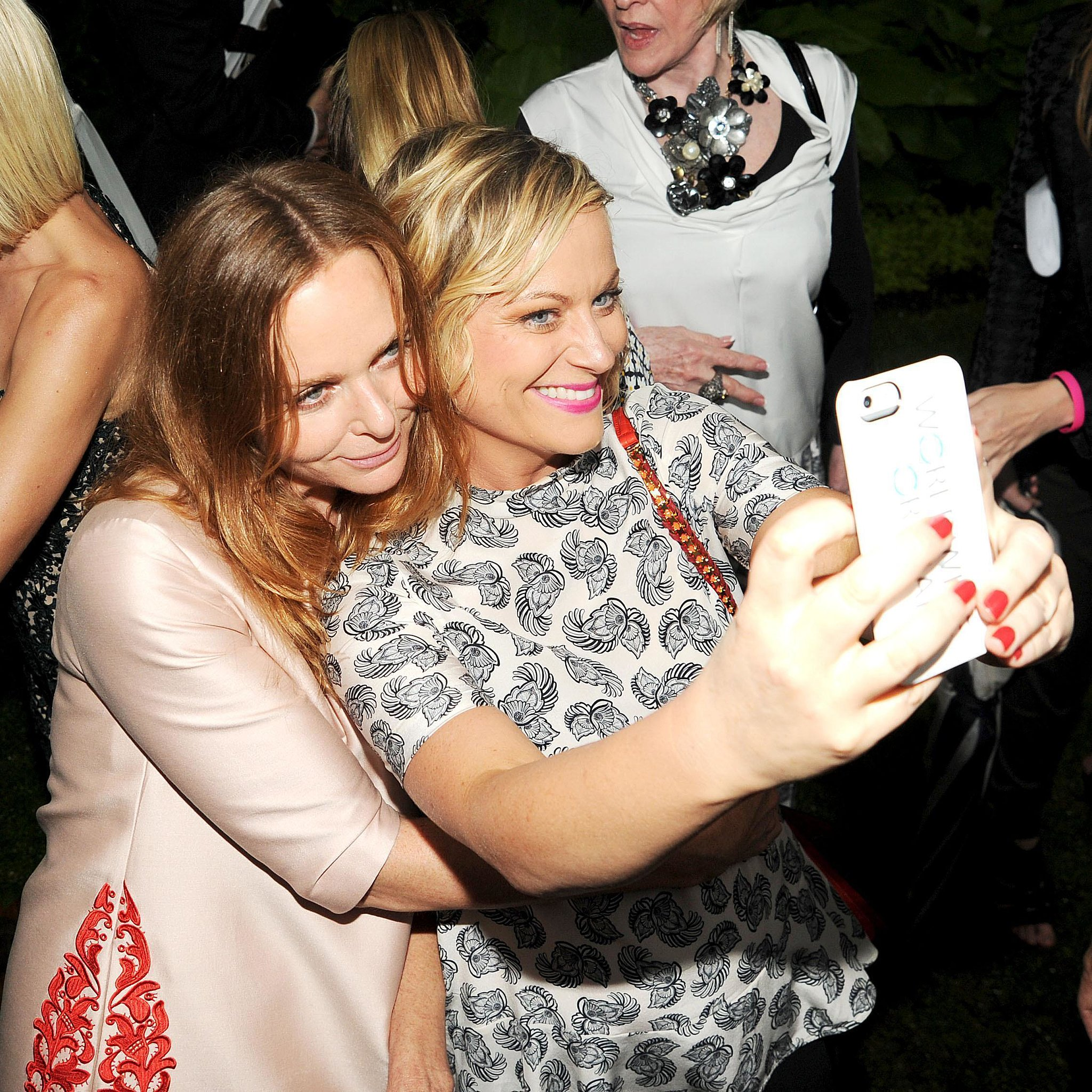 In June 2013, Amy Poehler snapped a selfie with Stella McCartney at Stella's Spring 2014 presentation in NYC.