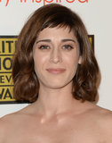 Lizzy Caplan showed up to the red carpet sporting bold brows and new, wispy bangs.