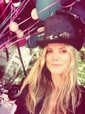 Heidi Klum celebrated her birthday with a top hat and balloons. Source: Twitter user heidiklum