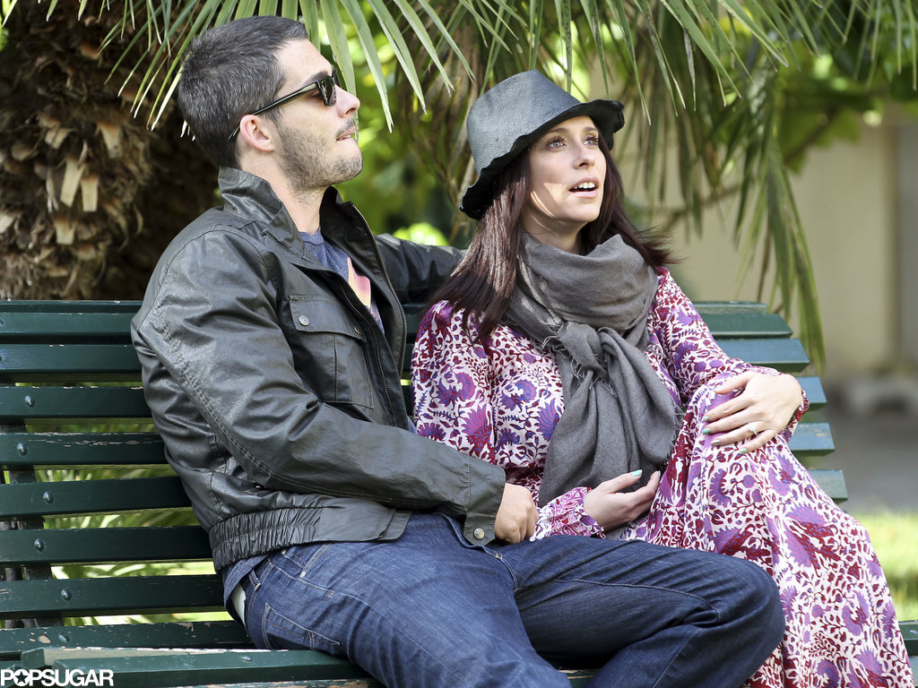 Jennifer Love Hewitt and Brian Hallisay sat on a bench.