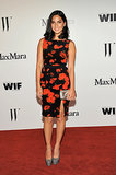 Olivia Munn stepped out in a Max Mara red-and-black, velvet, floral-print peplum-trimmed dress.