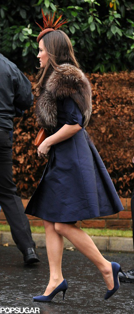 Nippy weather should never force a pretty dress to go undercover! Instead, do like Pippa at an Ireland wedding in 2012 and add some warmth with a vest, chubby, or artfully layered scarf.