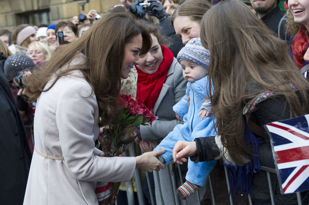 She was still keeping her pregnancy a secret in November 2012 when she was joined by Prince William to visit their namesake town, Cambridge.