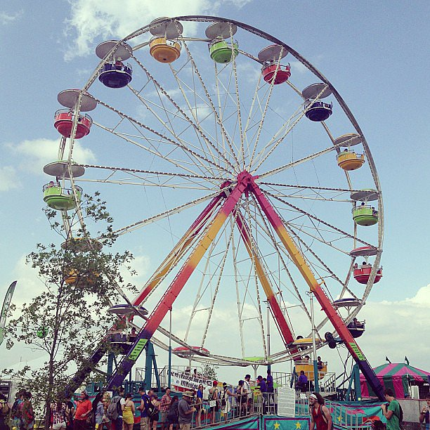 "One of Bonnaroo's core attractions is the Wheel of Lights (it's commonly referred to as ""Woli""). The Ferris wheel is a great way to see the entire campground — plus, it's one of the best ways to stay cool; the breezes are amazing! Source: Instagram user popsugarfashion"