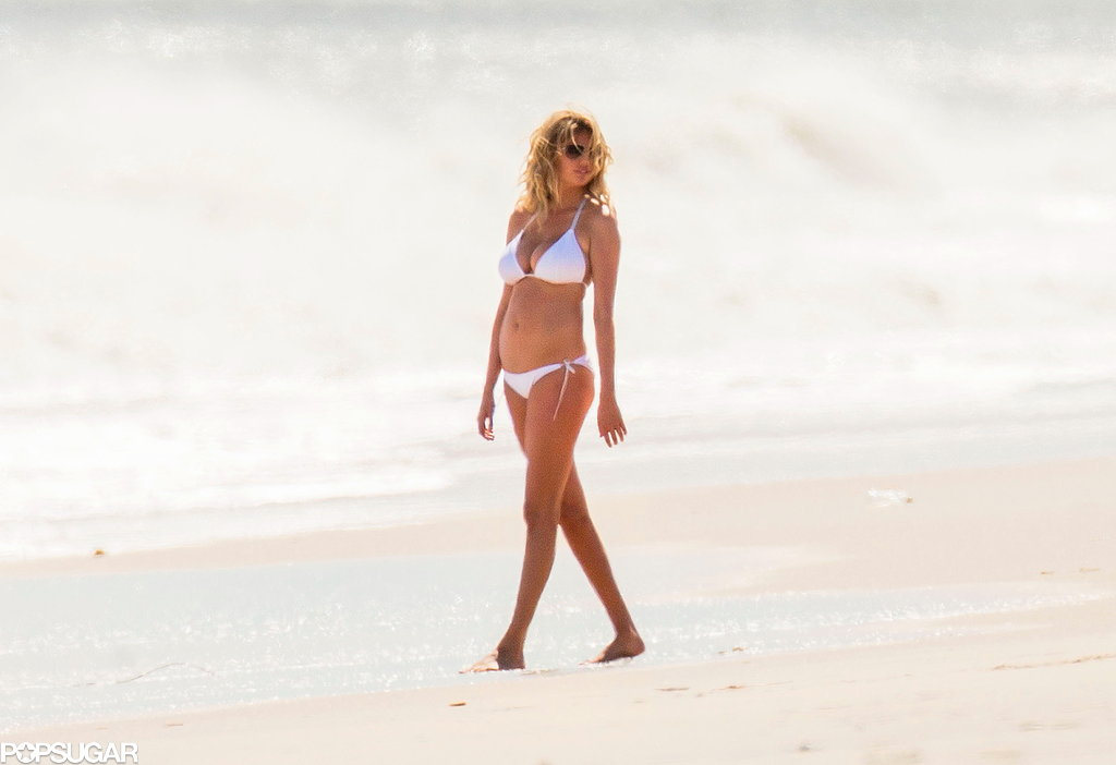 Kate Upton strolled around the beach in a white bikini.