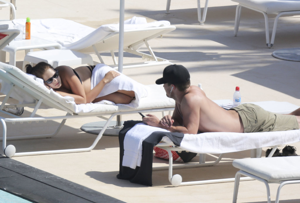 Stephen Amell and his wife relaxed by the pool on Thursday in Monaco.