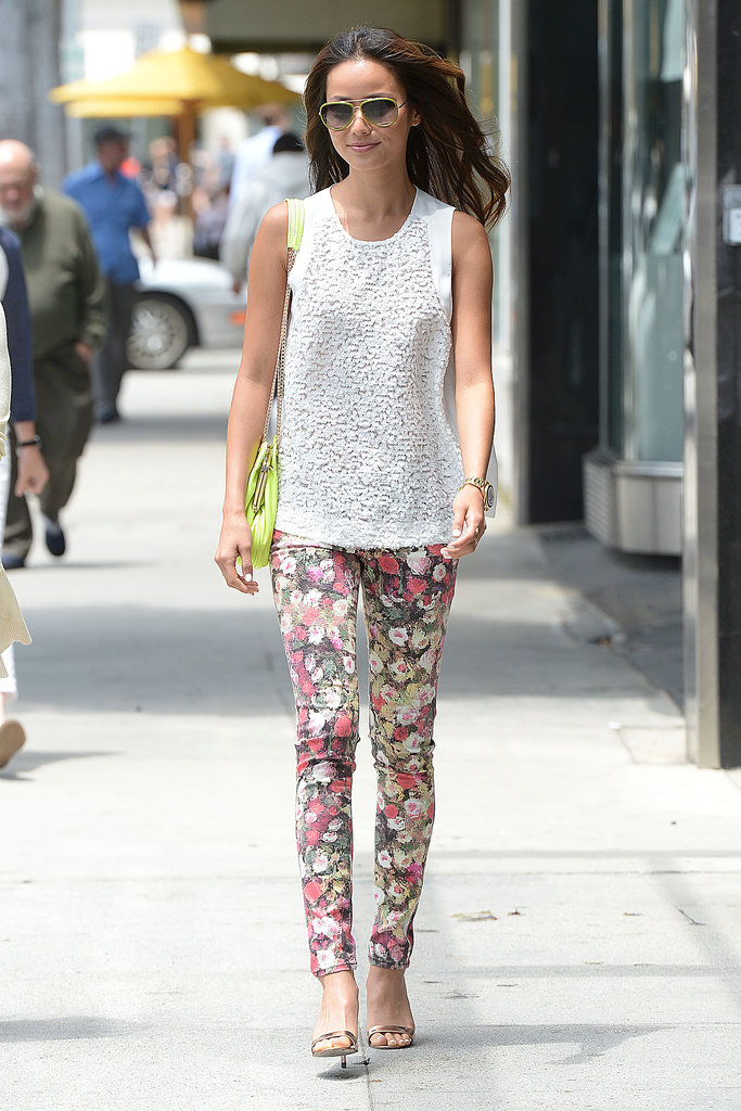 Jamie Chung spotlighted her legs via floral skinny denim, then injected even more flair with her neon yellow bag.