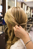 To complete the look, pull a section of hair to match the twisted-back part behind your ear. This section should come from the same side you started your braid on, directly above the braid.