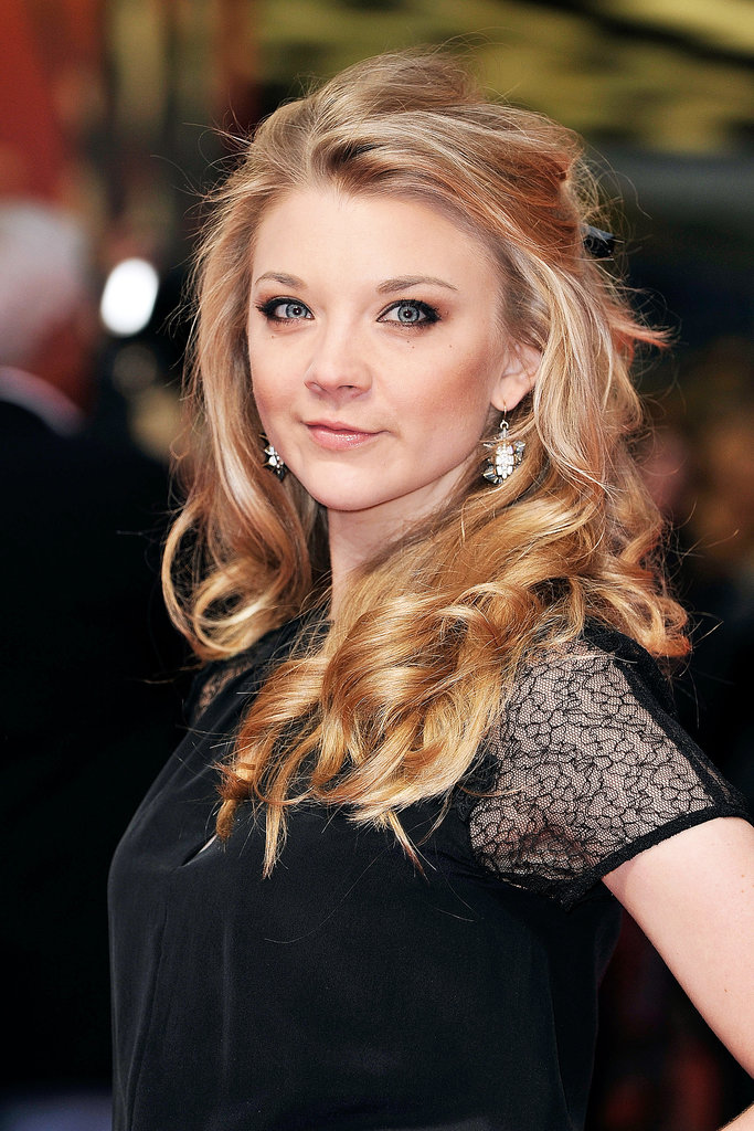 Game of Thrones star Natalie Dormer was at The Heat's screening with voluminous, glossy waves. She complemented the feminine look with bronzed makeup.